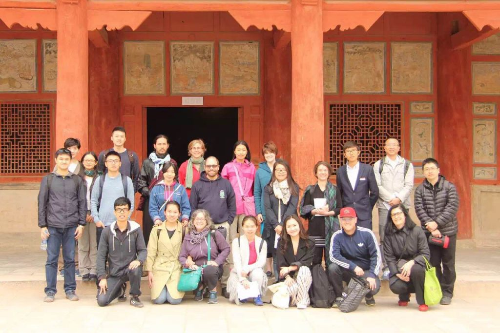 Daigengna and fellow program participants in Dunhuang