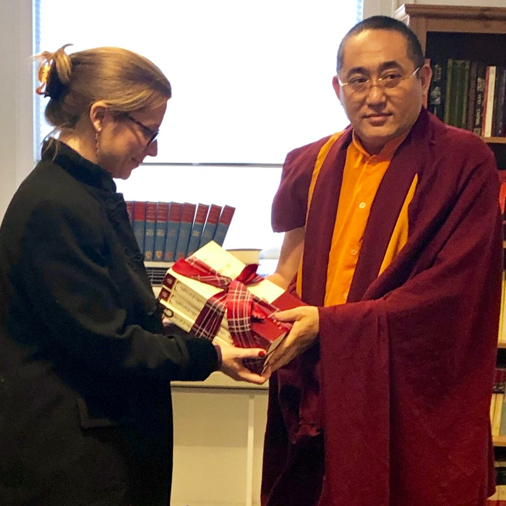 Kathog Trungpa Rinpoche hands newly published books to our centre director, Sarah Richardson.